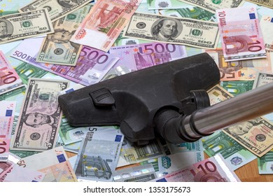 Paper money on the floor and vacuum cleaner
