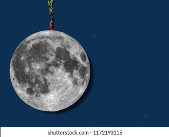 paper moon hanged with a rope over sky with stars, useful for merry christmas greeting cards