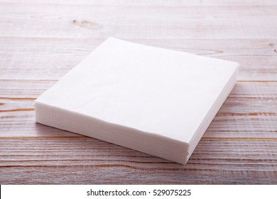 Paper napkin on wooden table close up top view mock up for design. Place for text