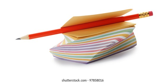 Paper note and a red pencil. It is isolated on a white background