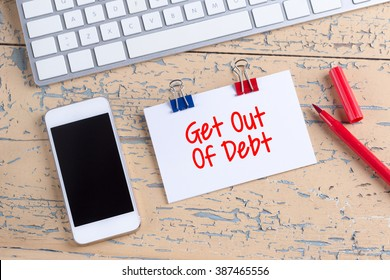 Paper note with text Get Out Of Debt