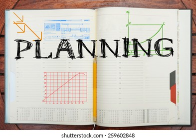 paper notebook with inscription Planning