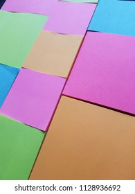 paper notebooks for notes in fluorescent colors, background and texture