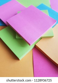 paper notebooks for notes stacked in fluorescent colors, background and texture