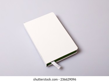 Paper notepad blank cover on white table