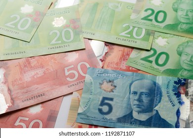 Paper notes from Canada. Dollar. Canadian cash. Top view of bills spread and variation of amounts.