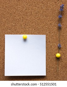 Paper notes on a background of cork board  with lavender flower.