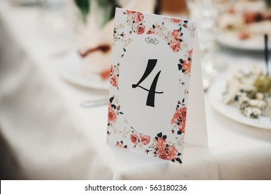 The paper with number stands on the table