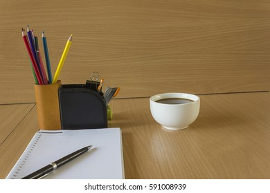 Paper and office supplies on the table wood, Working in morning time, business and finance on wood desk, thinking and analysis for success.