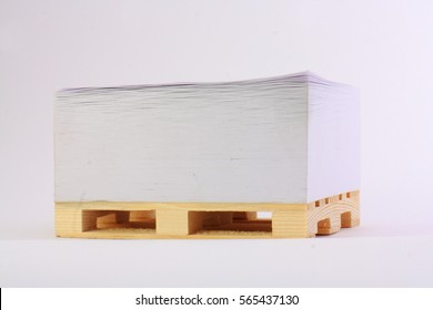 Paper on a wooden pallet and a light background