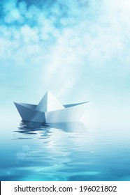 Paper origami boat on azure water