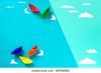 Paper origami composition, sea travel and summer vacation minimal concept, flat lay, view from above, space for a text