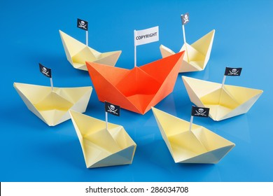 Paper origami ship and several pirate Vessel with black flag Jolly Roger