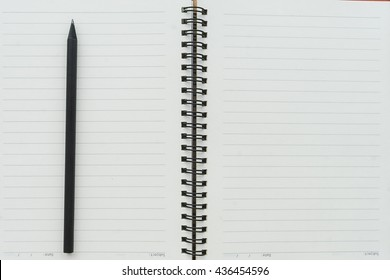 paper and pen. Top view with copy space