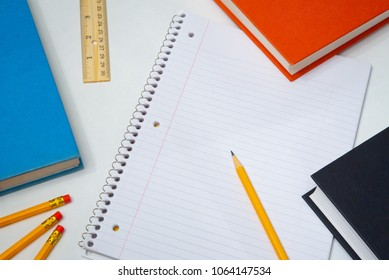 Paper and Pencil with School Supplies