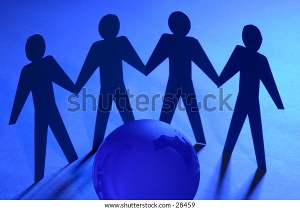 paper people standing around glass globe. conceptual idea for family, unity, and teamwork.