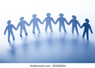 Paper people standing together hand in hand. Team, society, business teamwork concept.