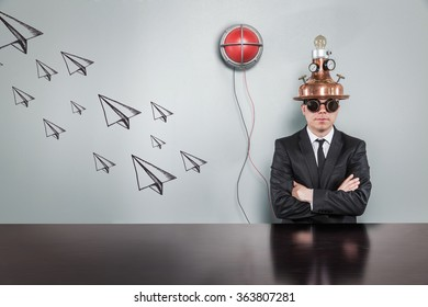 Paper plane concept with alert light and vintage businessman