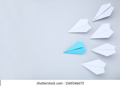 Paper plane leader on grey background
