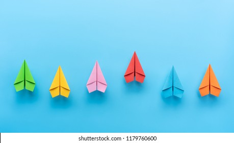 Paper planes on blue background, Business competition concept.