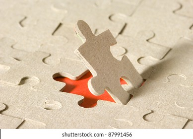 Paper puzzles on a red background. One puzzle is open.