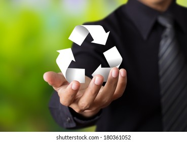 Paper recycle sign in business man hand