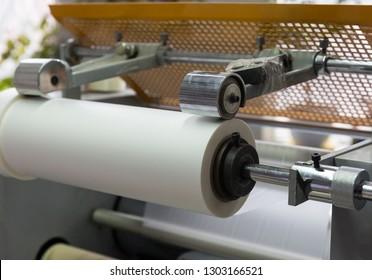 paper roll machine, cut and fold, closeup