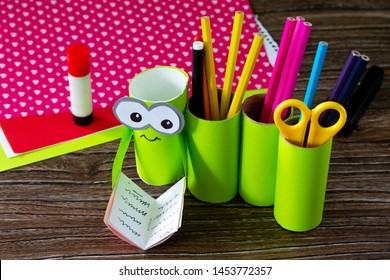 Paper Roll Pencil Holder the new school year on wooden table. Welcome back to school. Children's Art Project, needlework, crafts for kids.