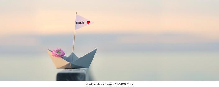paper sail boat at the beach