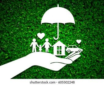 paper salesman agent hand holding family protection on green leaves background. concept accident prevention healthcare insurance.