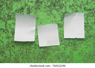 Paper scraps placed on the green background