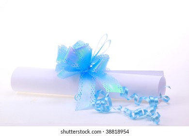 Paper scroll and blue bow isolated on white background