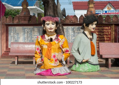 Paper sculptures of a man and a woman used for rituals at a Buddhist temple during Songkran celebration in Battambang, Cambodia