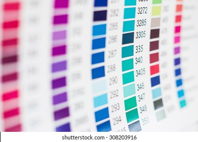 Paper sheet with printed  table of color swatches with their numbers