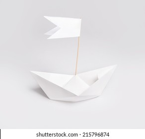 Paper ship with flag