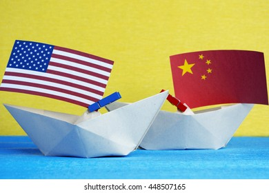 paper ship with Flags of  USA and China. conflict in South China Sea, concept shipment or free trade agreement and membership.