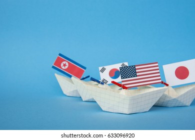 paper ship with Flags of USA, China, North Korea, South Korea, Japan And other East Asian countries
