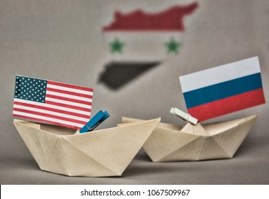 paper ship with Flags of USA and Russia. conflict in Syria sea, concept shipment or free trade agreement and membership. grunge image