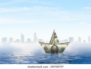Paper ship floating on water on waves