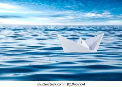 Paper ship and ocean
