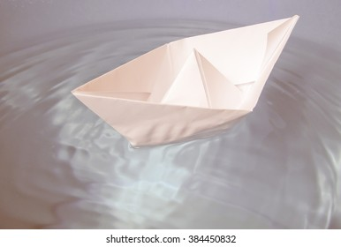 Paper ship in water picture vintage