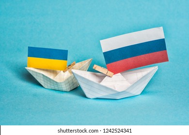 paper ships with flags of Ukraine and Russia, symbol of conflict at sea of Azov