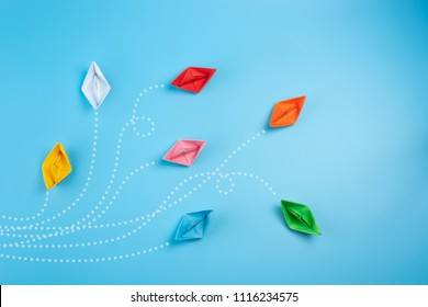 Paper ships on blue background. Business competition, different vision creative and Innovative solution for business concepts.