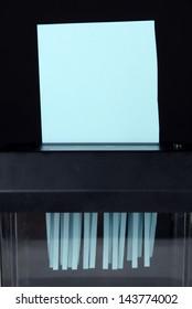 Paper shredder machine, isolated on black