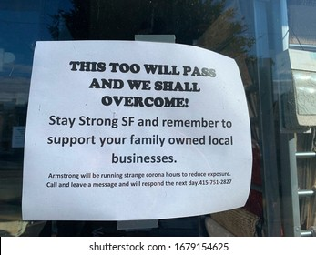 A paper sign on the window of a closed business giving support to family owned businesses during the Coronavirus pandemic. March 21, 2020, San Francisco, CA.