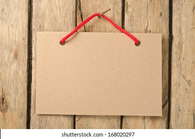 Paper signboard on the old wooden background