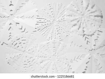 Paper snowflakes on white background. Handmade decoration background for Christmas and New Year celebrations.