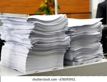 the paper stack in office as a symbol of bureaucracy and civil servants