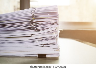 Paper stack on the desk related to business functions. With morning light,soft focus