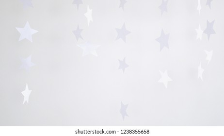 Paper stars hanging and rotating decoration on a white background. Christmas concept.